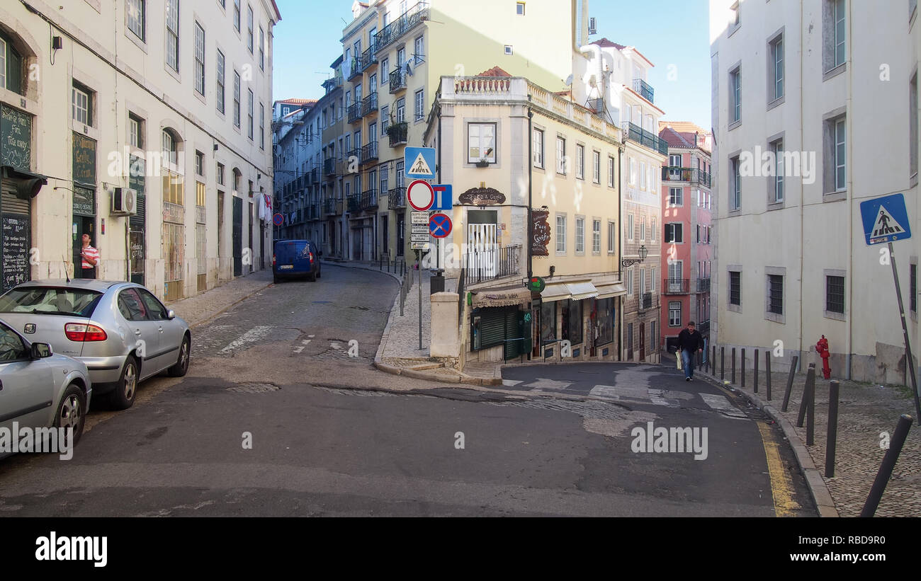 LISBON, PORTUGAL-DECEMBER 24, 2016: The inclined streets and 3-storey buildings in a typical street of Bairro Alto District - Stock Image