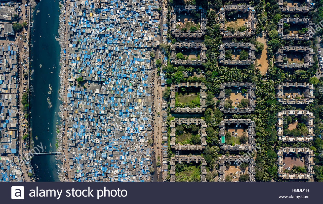 Mumbai. AMAZING aerial images have captured the stark contrast and inequality where rich meets poor all across the world. The spectacular bird's eye view pictures show the landscape as an affluent area gives way onto one where people may be suffering from poverty. The stunning shots show this crossover of the rich and poor all across South Africa, Kenya, Mexico and even the USA. The remarkable photographs form of africanDRONE founder and photographer Johnny Miller's (37) Unequal Scenes project. Johnny Miller / mediadrumimages.com Stock Photo