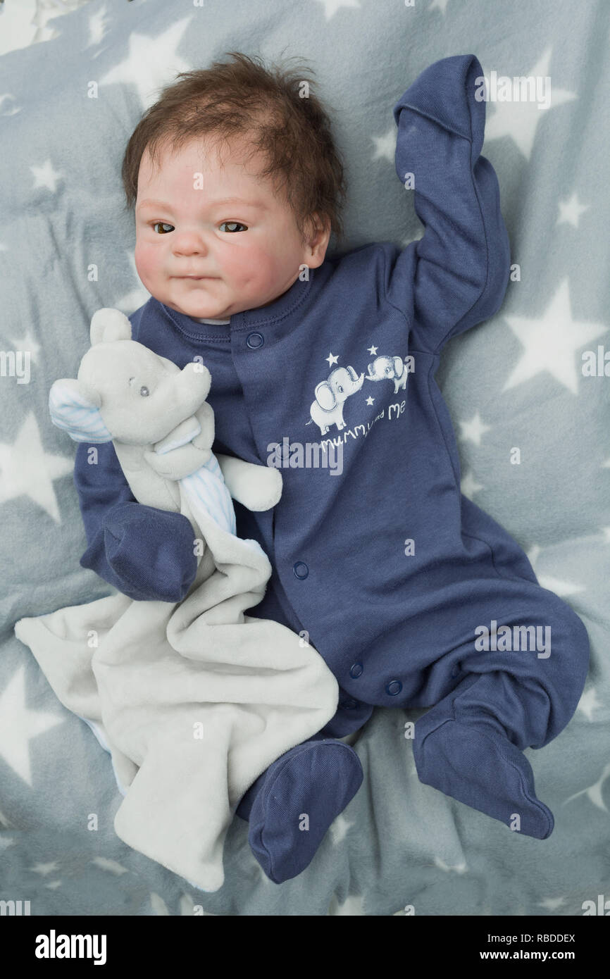 Reborn baby doll. Vinyl sculpt, Coco Malu by Eliza Marx. A reborn is an anatomically correct doll, hand painted to give the appearence of a real baby. - Stock Image