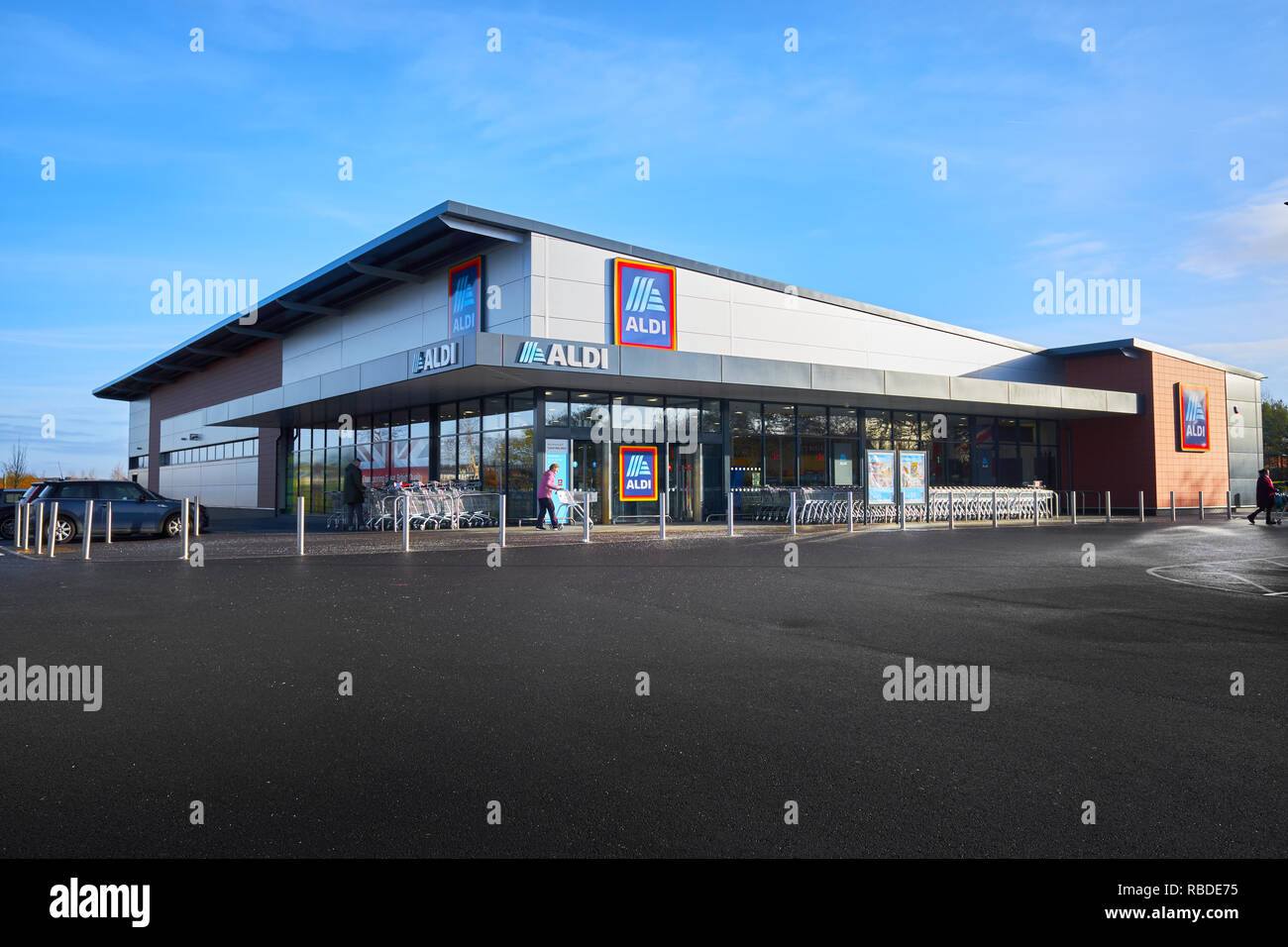 Aldi store at Saxon Way West, Corby, England, on a sunny winter day. - Stock Image