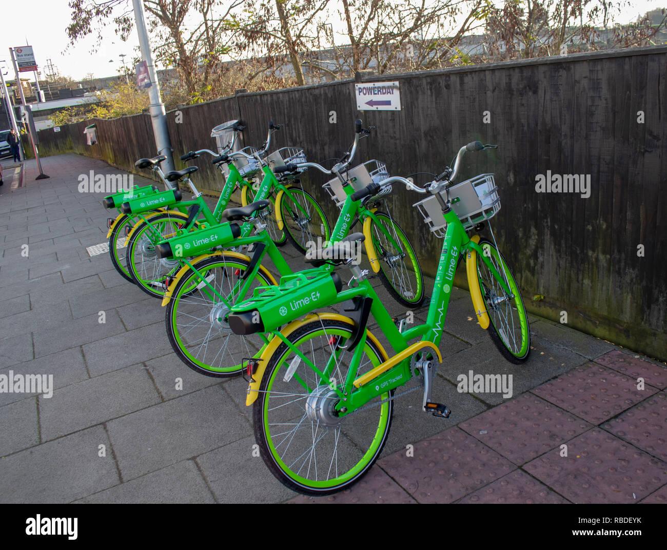 Green bikes parked outside Willesden Junction Station - Stock Image