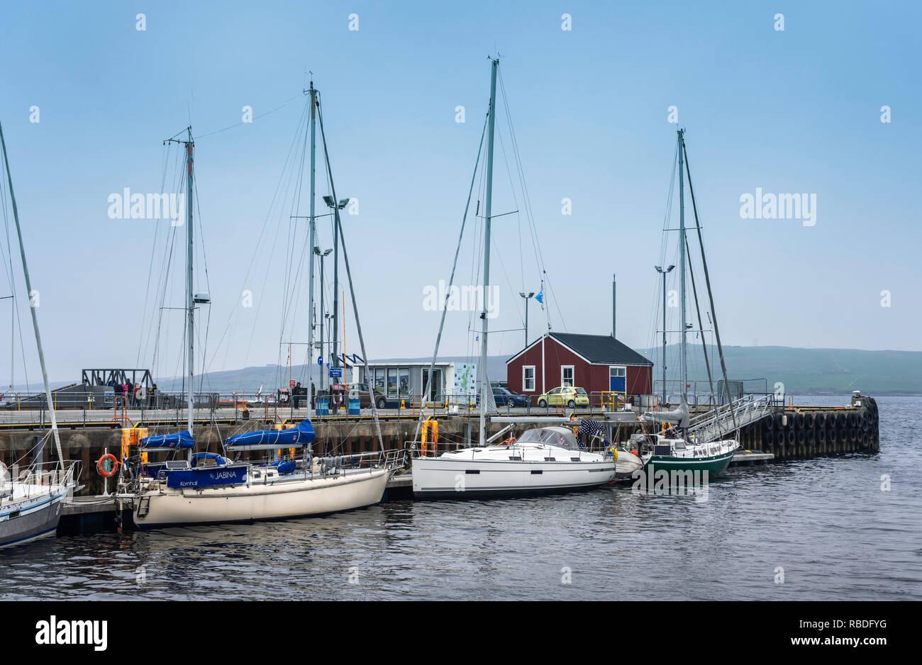 The dock with boats at the port city of Lerwick, Shetland, Scotland, United Kingdom, Europe. - Stock Image