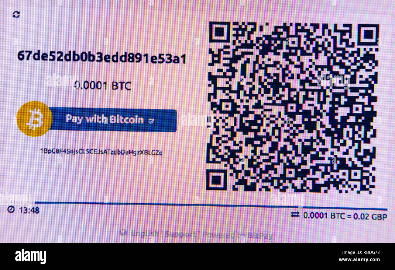 Pay with BitCoin logo and QR code on a website - Stock Image