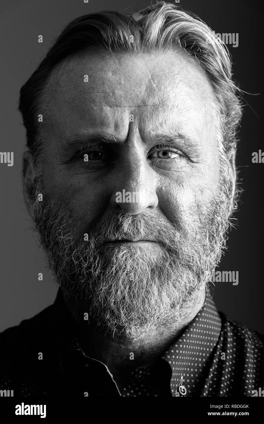 Face of mature bearded man in black and white - Stock Image