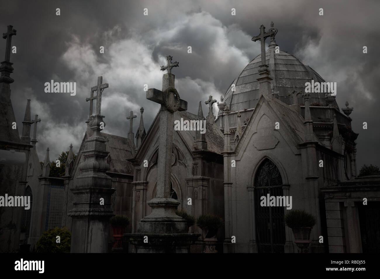 Old dark european cemetery against a dramatic cloudy sky