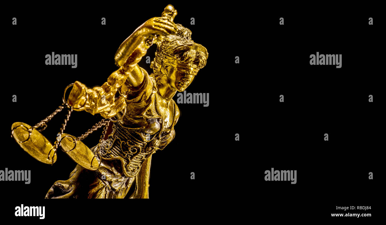 Golden Statue of lady Justice on the black background Stock Photo