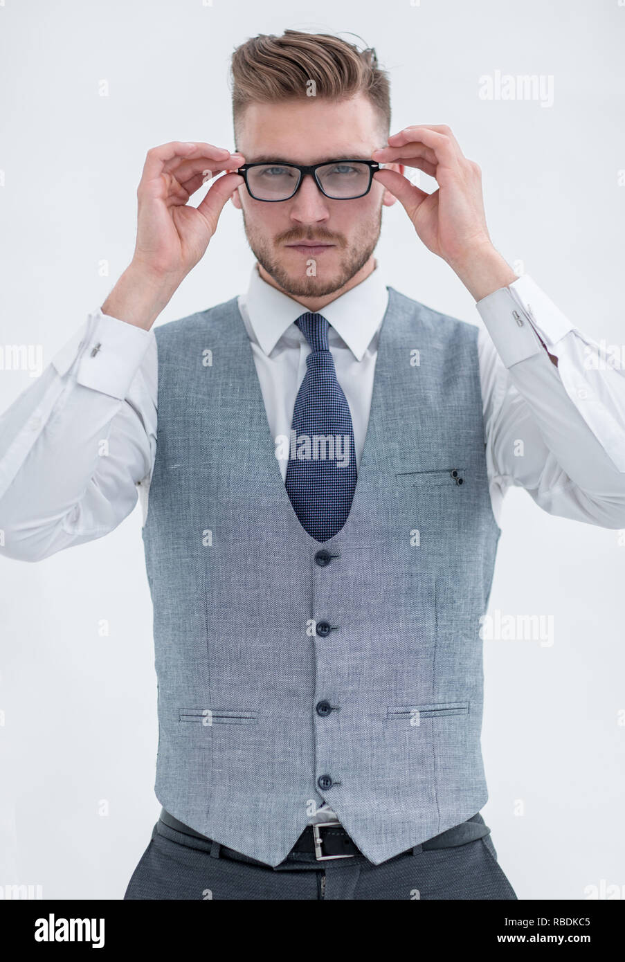 close-up of a businessman in a vest wearing glasses - Stock Image