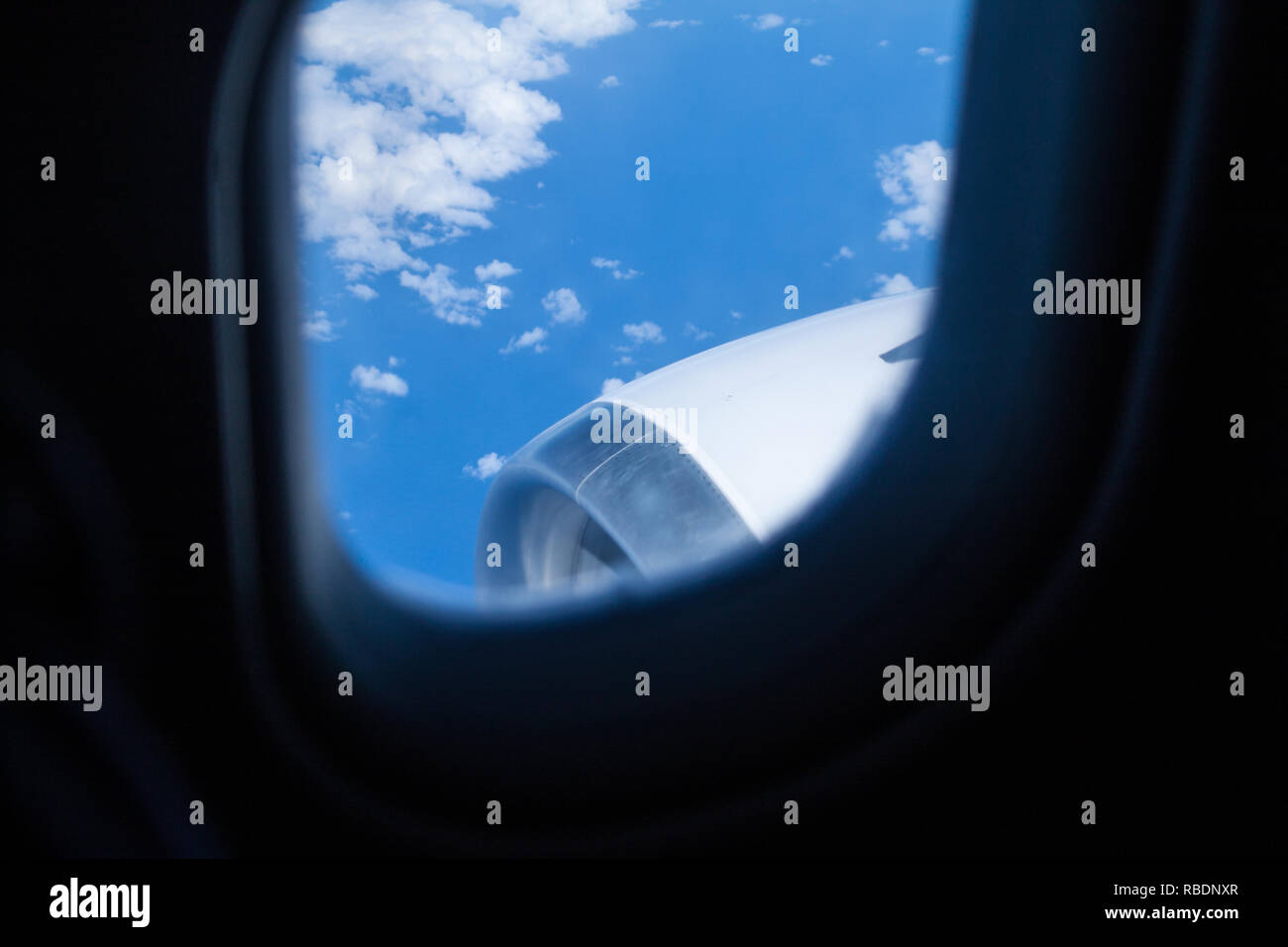 An engine of a large commercial airliner as seen thorough a window - Stock Image