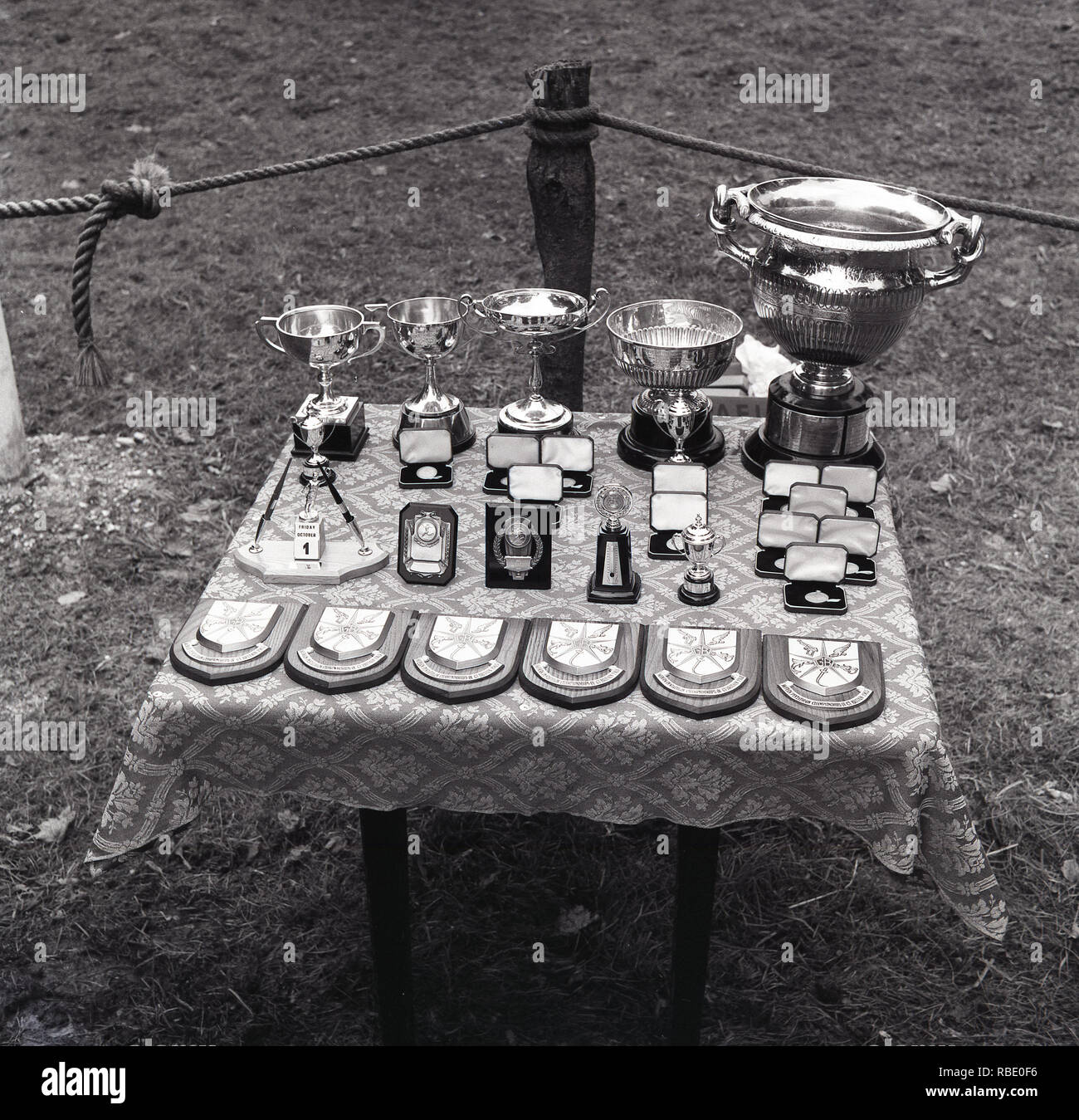 1965, historical, trophies on a table to be presented. These are trophies and prizes for the Modern Pentathlon Championships of Great Britain. Track and field sport in Britain in this era was amateur  and a trophy and plaque was the reward for the competitors taking part. - Stock Image