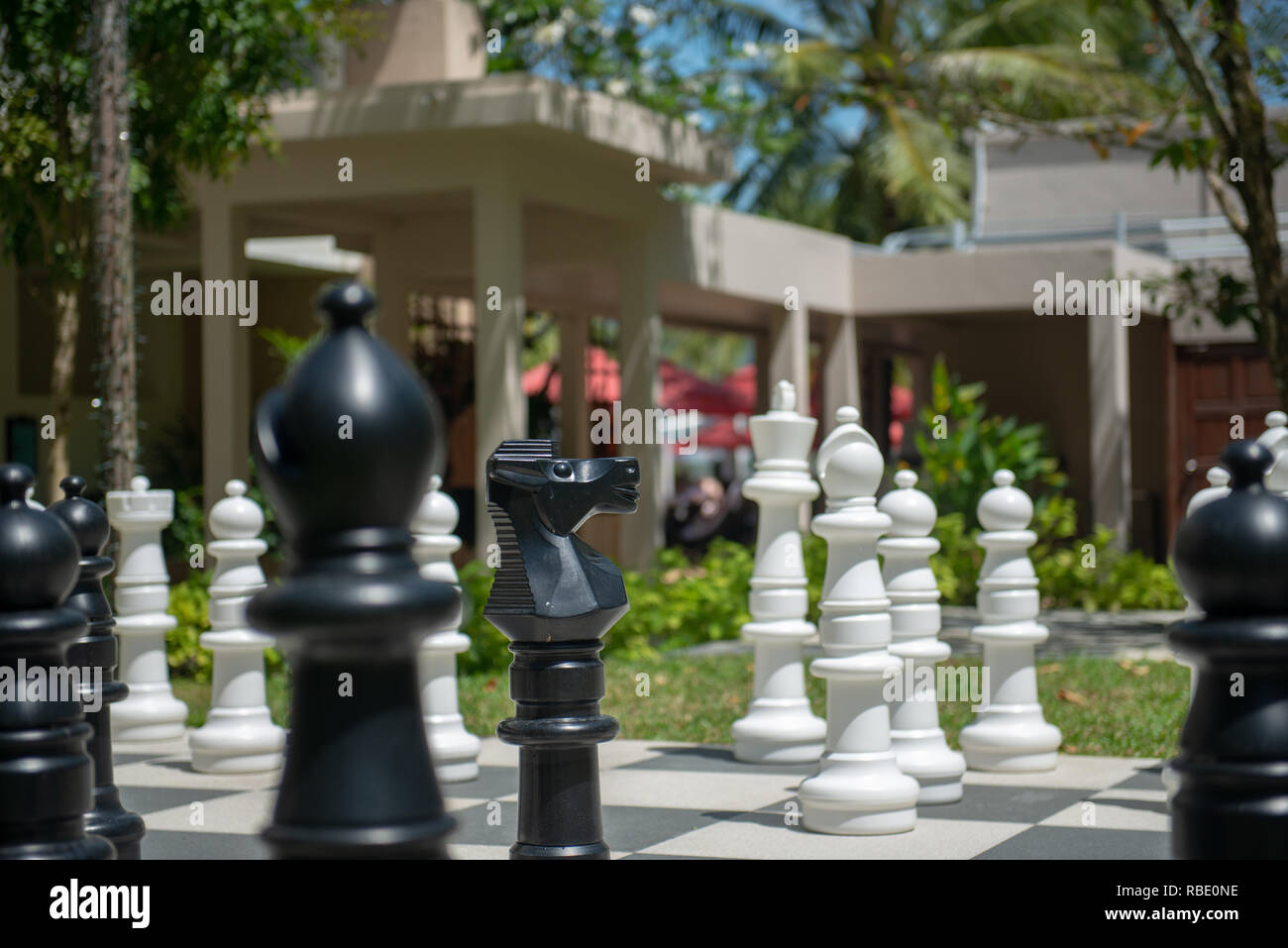 Big chessboard pieces - Stock Image