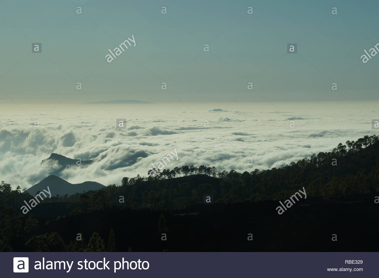 Wonderful view over the clouds in enigmatic light from the mountains - Stock Image