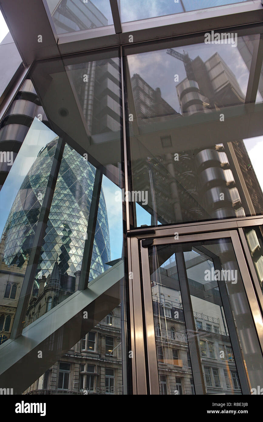 Reflection of Lloyd's building in the glass of The Scalpel, with the Gherkin showing through the other side. - Stock Image