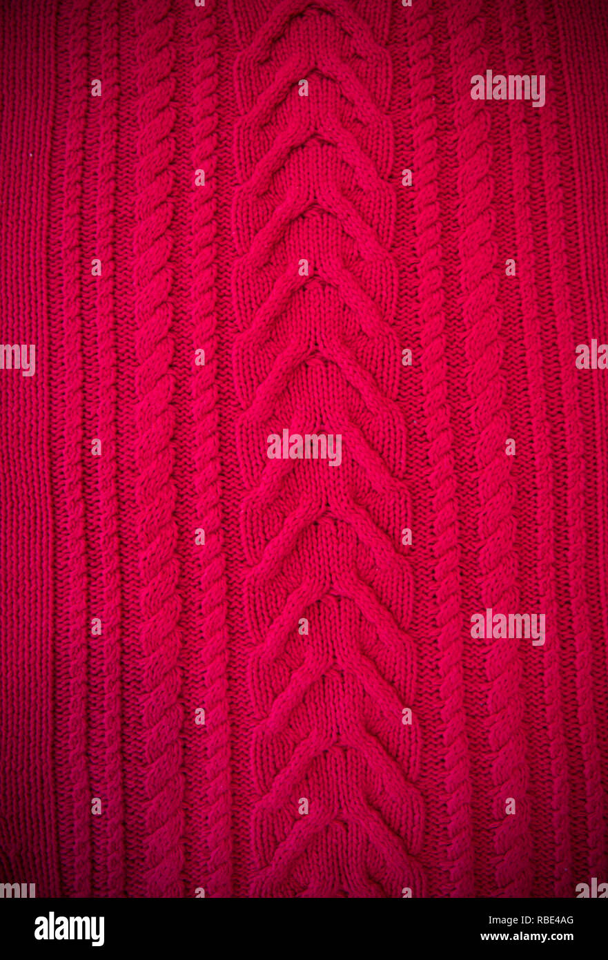 bb1fd1a9f51 Red Knitted pattern wool sweater texture close up. Handmade red knitting  wool texture background