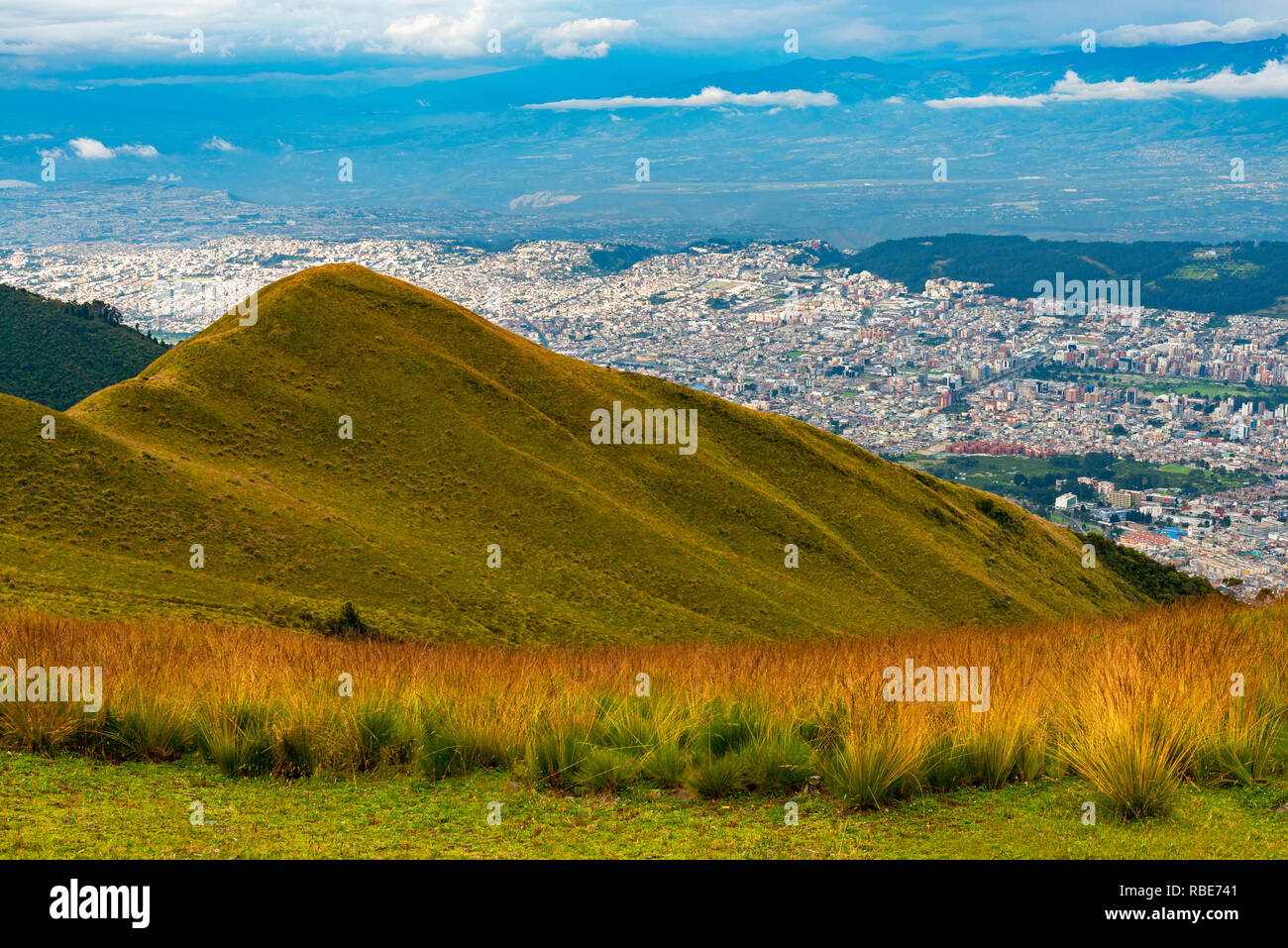 Aerial cityscape and skyline of Quito city seen from the Pichincha volcano, Ecuador. - Stock Image
