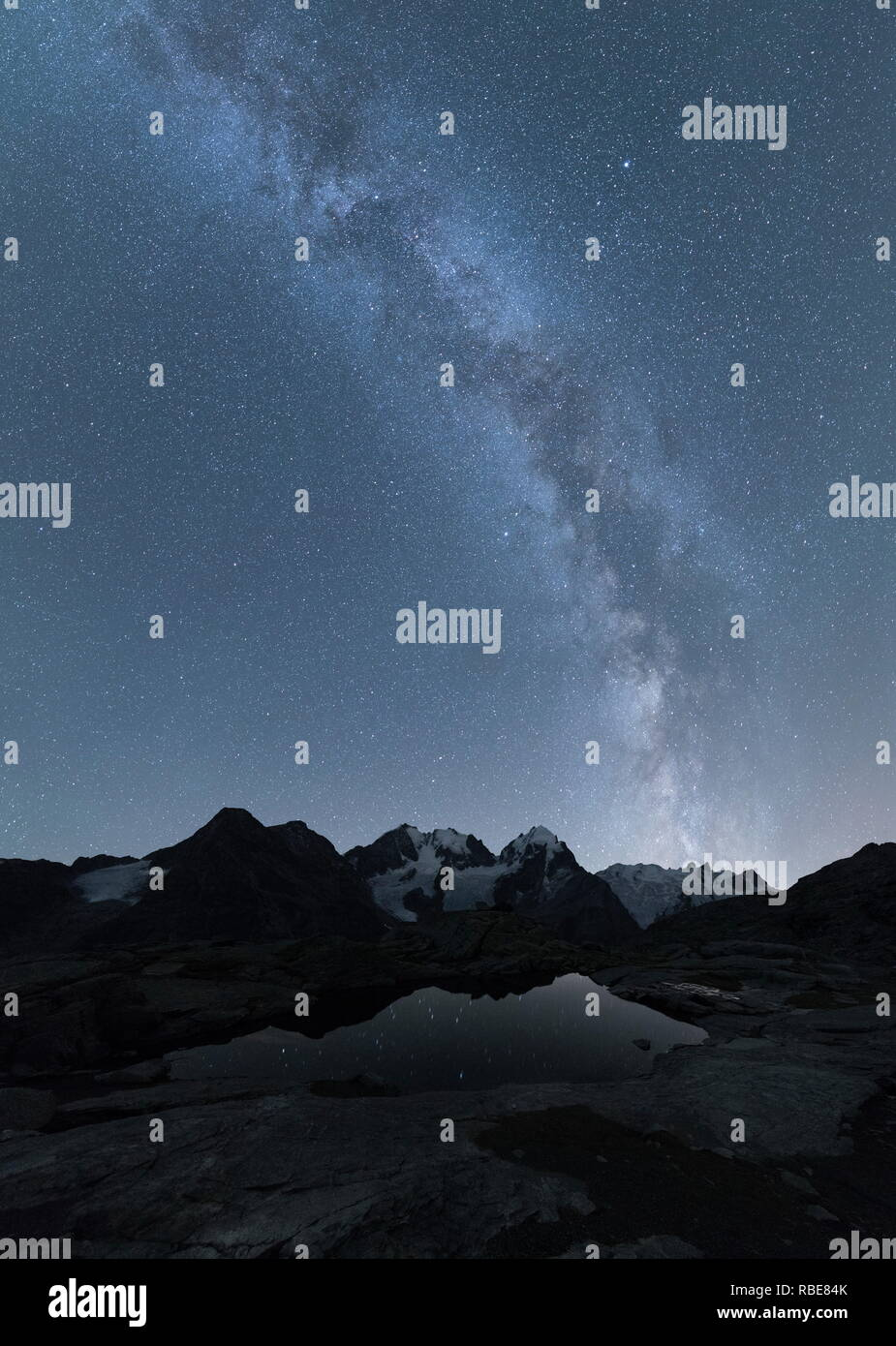 Panoramic of Milky Way on Piz Bernina, Fuorcla Surlej, Corvatsch, canton of Graubunden, Engadine, Switzerland - Stock Image