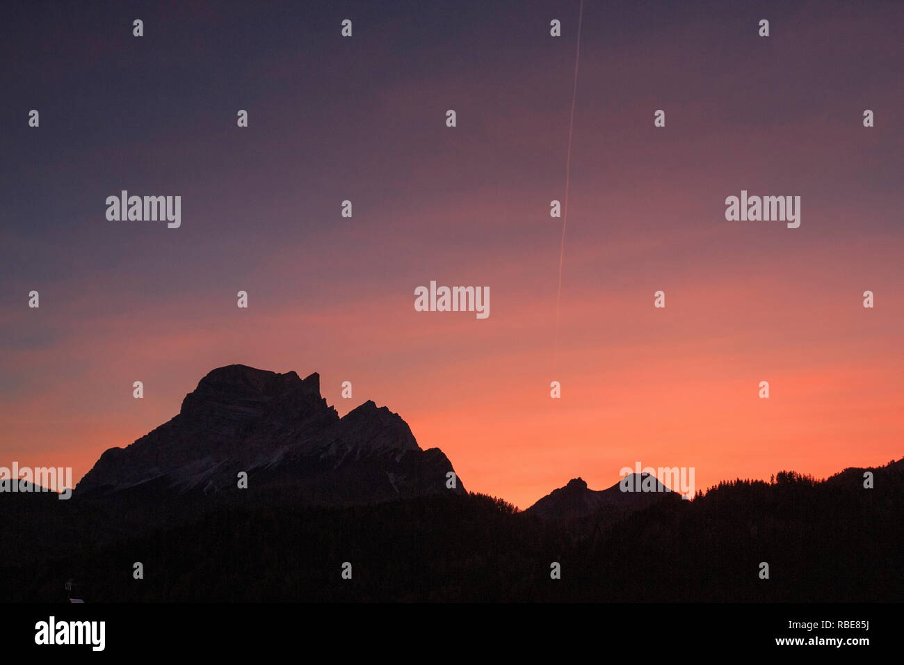 The sky turns pink at sunset on the rocky summit of Mount Pelmo Cadore Zoldo Dolomites Veneto Italy Europe - Stock Image