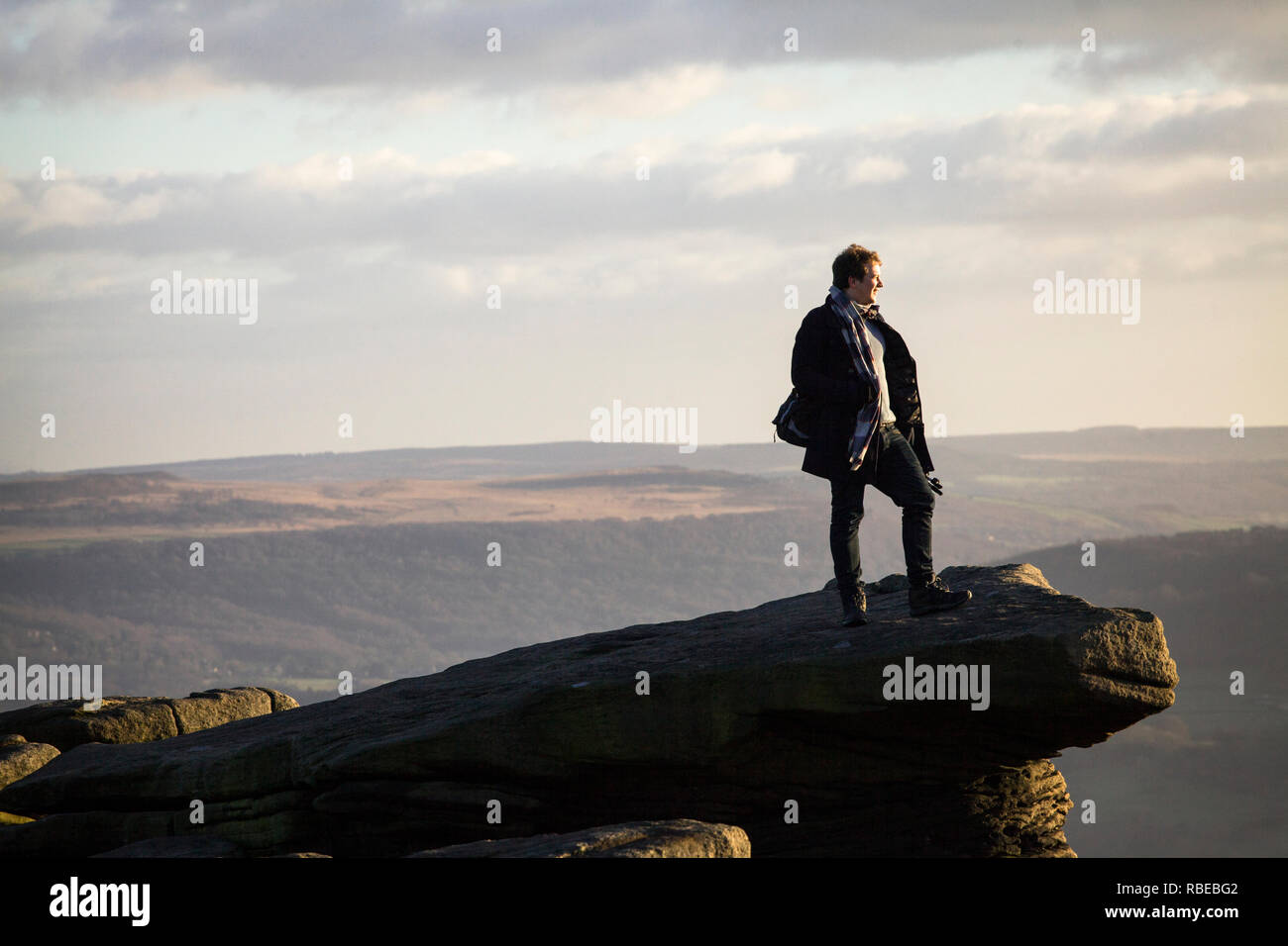 Young man enjoys a view in the Peak District, England - Stock Image