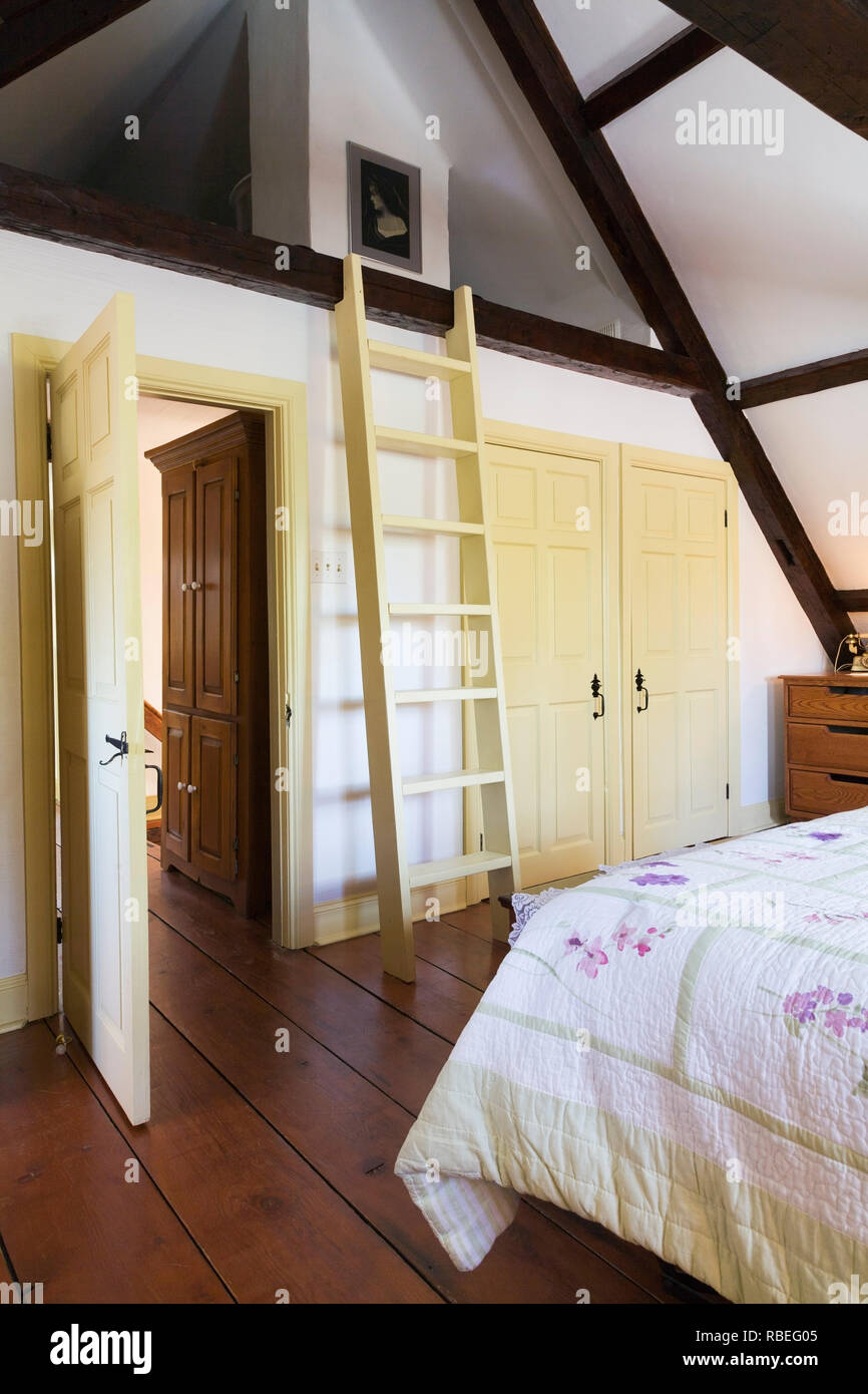 Partial View Of The King Size Bed And Old Wooden Ladder Leading To The Attic In The Master Bedroom On The Upstairs Floor Inside An Old Home Stock Photo Alamy
