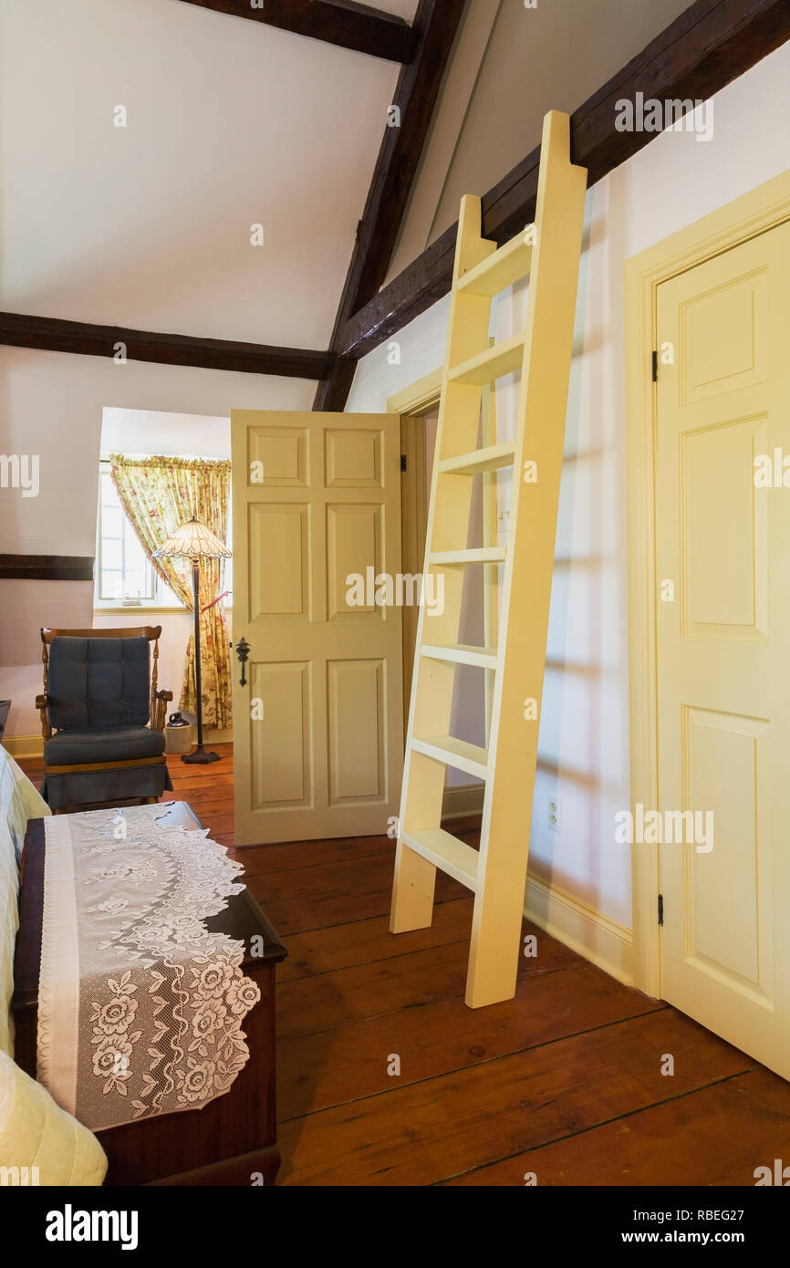 Old wooden ladder leading to the attic in the master bedroom on the ...