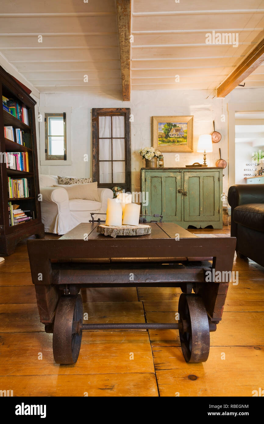 Living Room With Old Wooden Grain Scale As Coffee Table