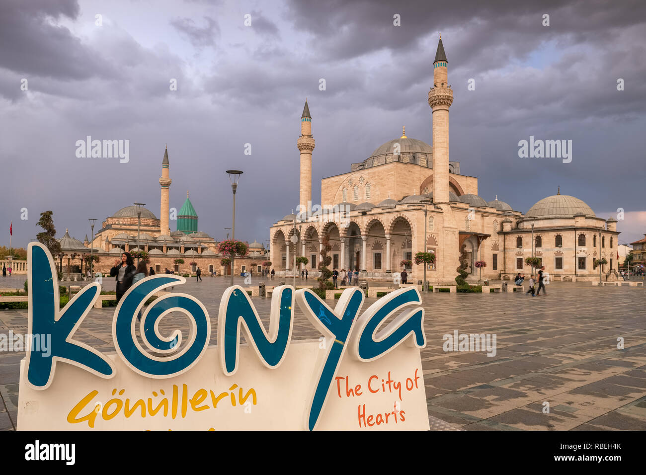 Konya, Turkey - October 20, 2018: The central square of the old town with the Mevlana Museum on the background and Selimiye Mosque - Stock Image