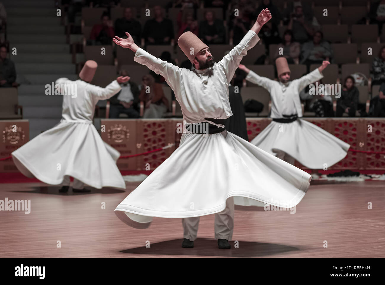 Konya, Turkey - October 20, 2018: Semazen or Whirling Dervishes at Mevlana Culture Center in Konya, Turkey - Stock Image