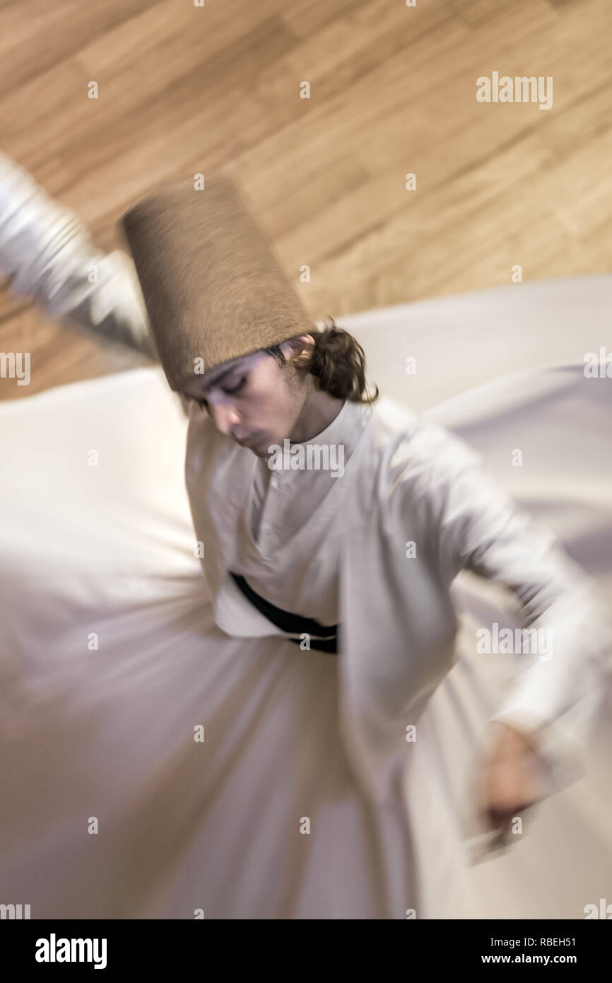 Konya, Turkey - October 21, 2018: Semazen or Whirling Dervishes at Mevlana Culture Center in Konya, Turkey - Stock Image