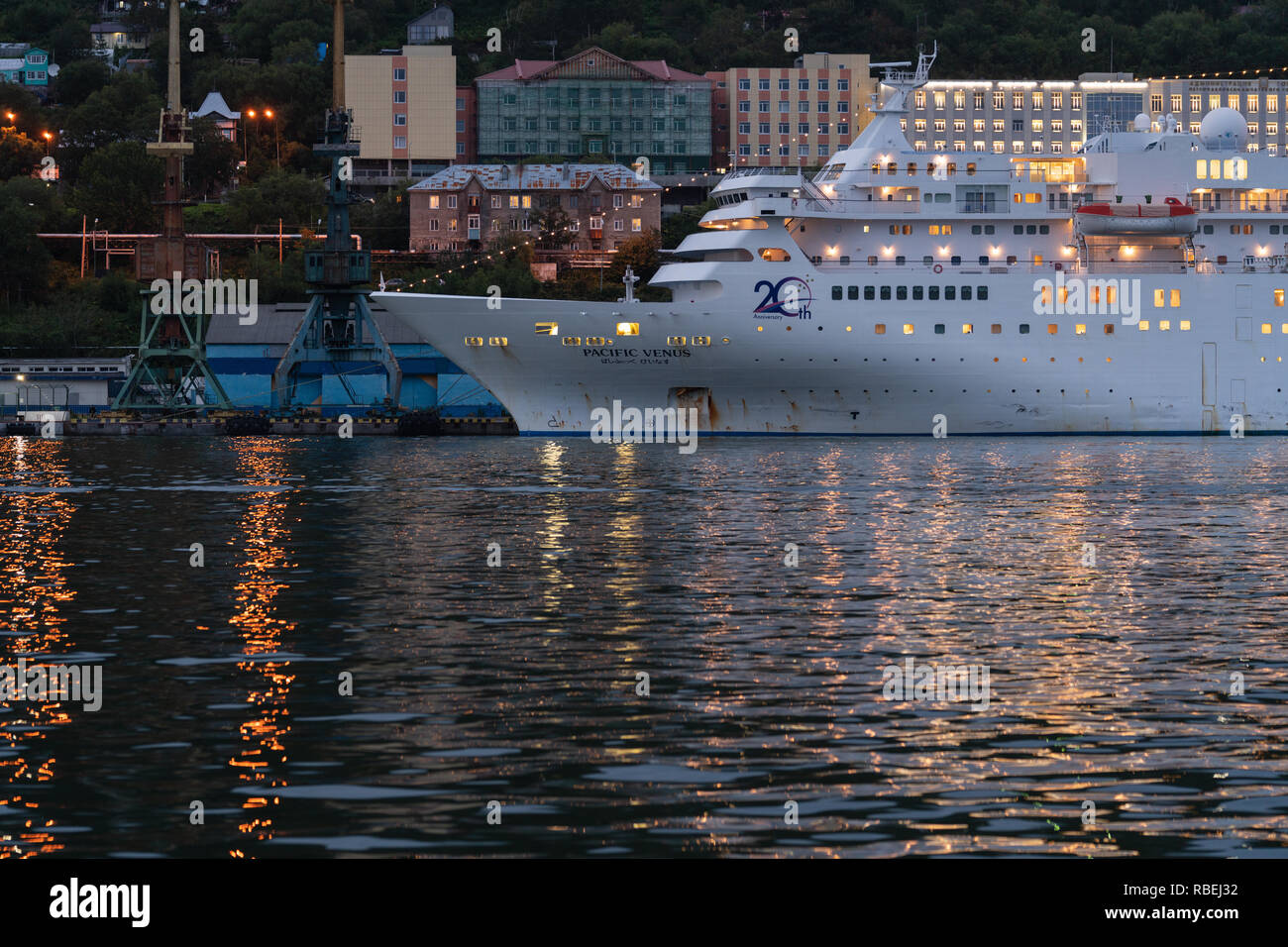 Night view of Japanese cruise liner Pacific Venus anchored at pier in commercial sea port of Petropavlovsk-Kamchatsky City - Stock Image