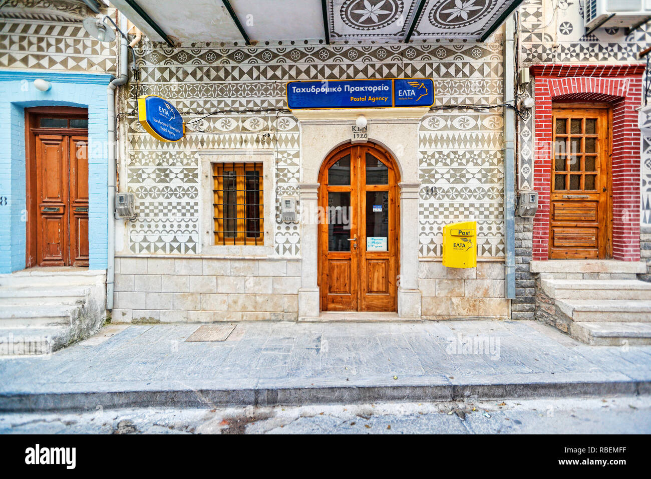 The post office decorated with the famous geometric scratch patterns in the medieval mastic village of Pyrgi on the island of Chios, Greece Stock Photo