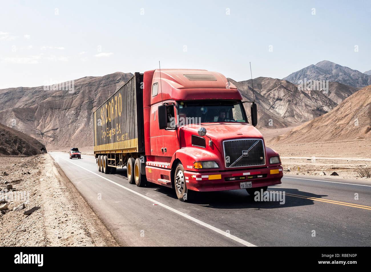 Truck driving on Panamerican Highway. Huarney, Department of Ancash, Peru. - Stock Image