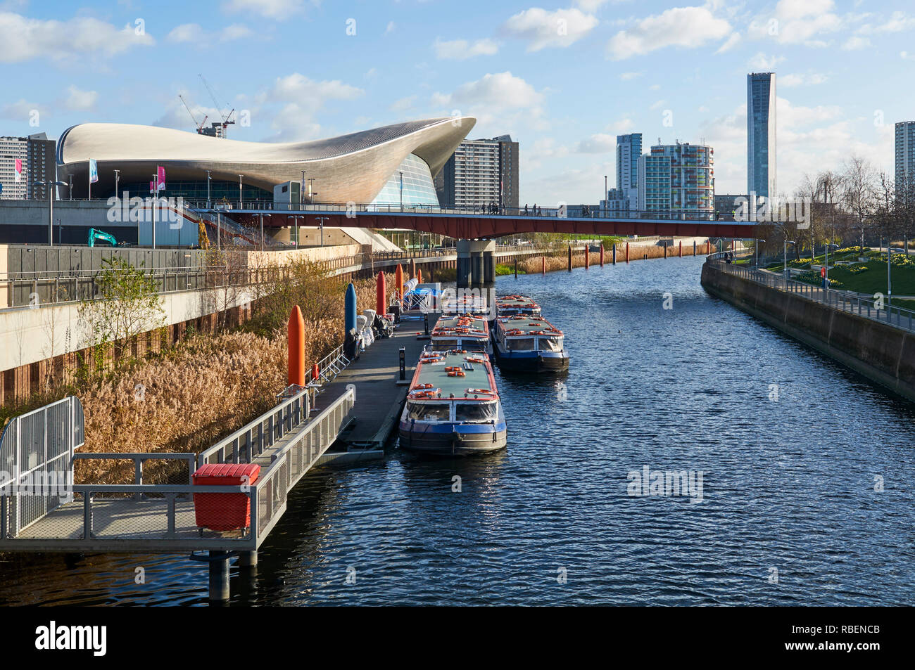 The Waterworks River and the London Aquatics Centre at Stratford, East London UK, with river boats - Stock Image