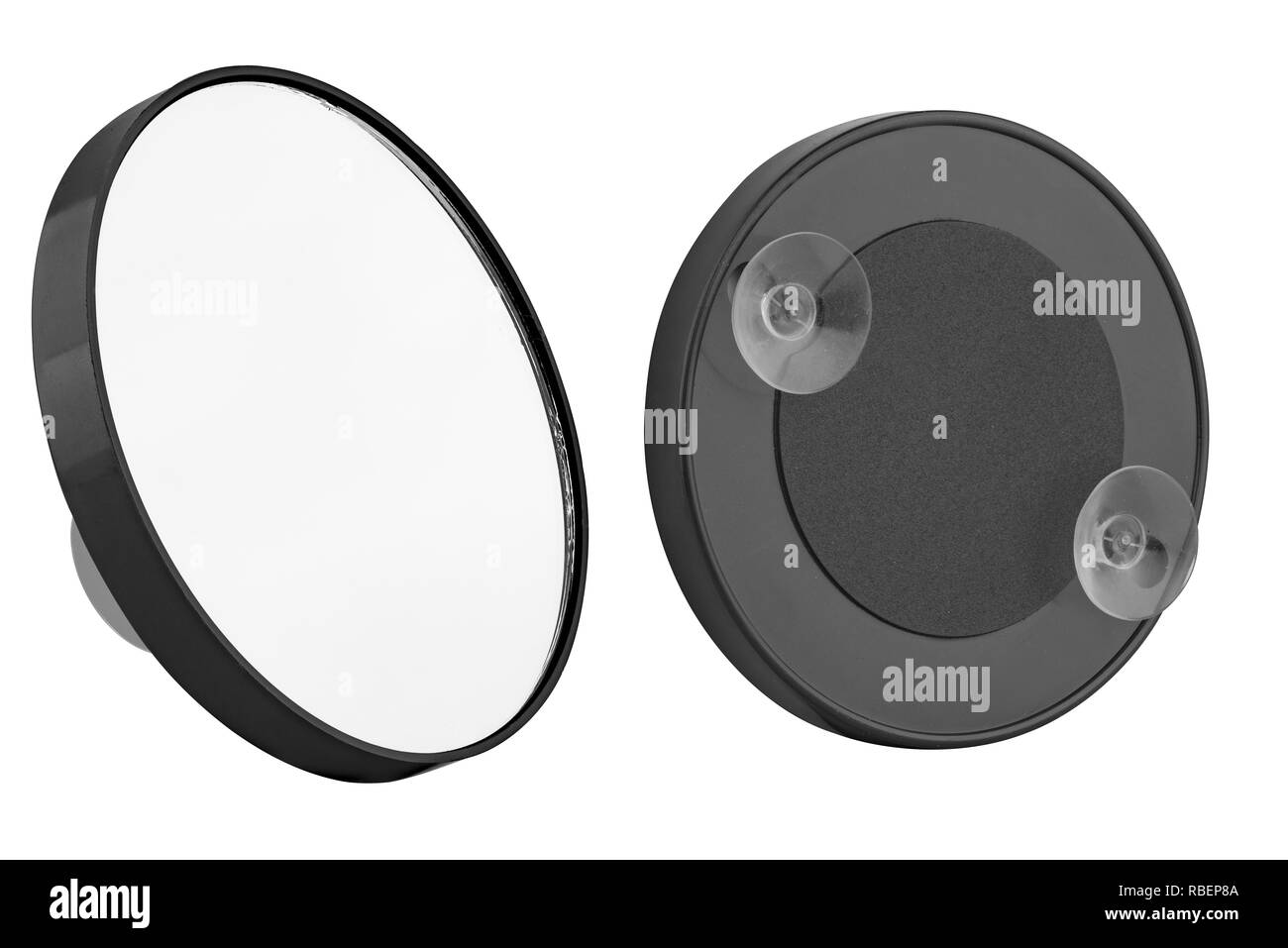 Black plastic round pocket mirror for make-up, with two suction cups on the back, beauty product isolated on white background - Stock Image