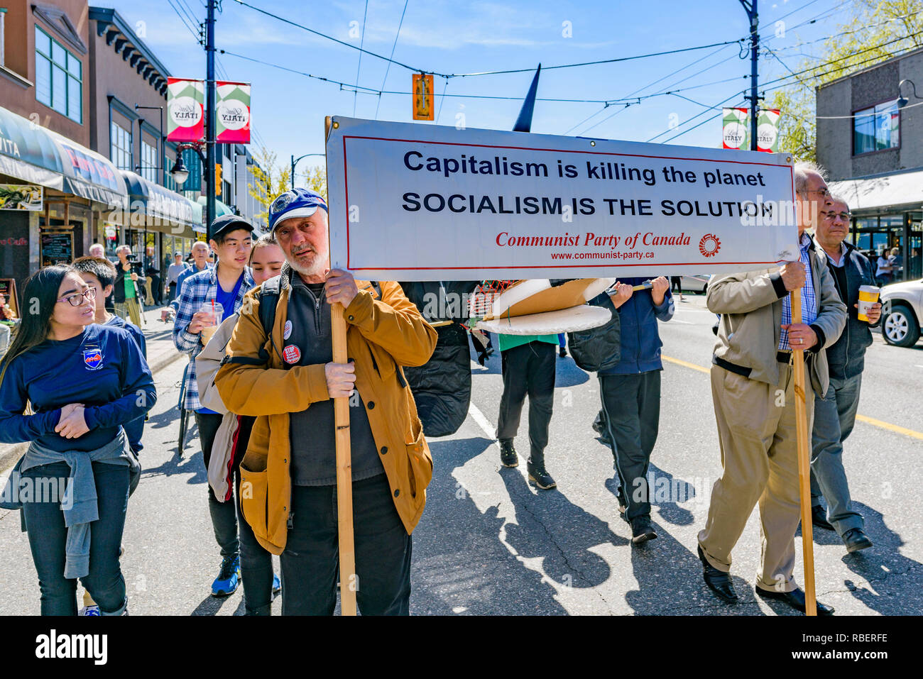 Communist Party banner, 2018 Earth Day Parade, Commercial Drive, Vancouver, British Columbia, Canada. - Stock Image