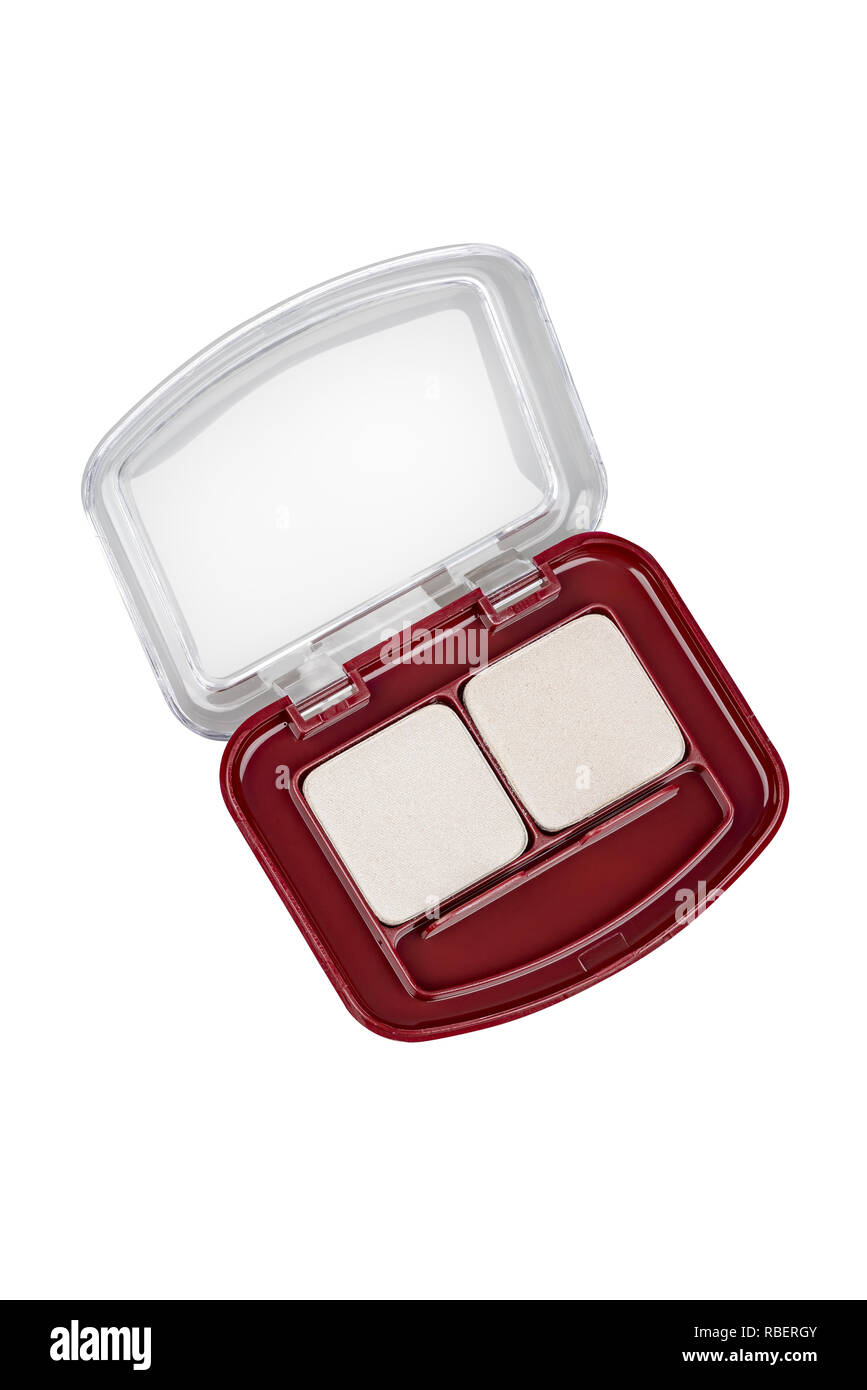 Two shades face powder foundation in open red container with transparent lid, beauty product isolated on white background, clipping path included - Stock Image