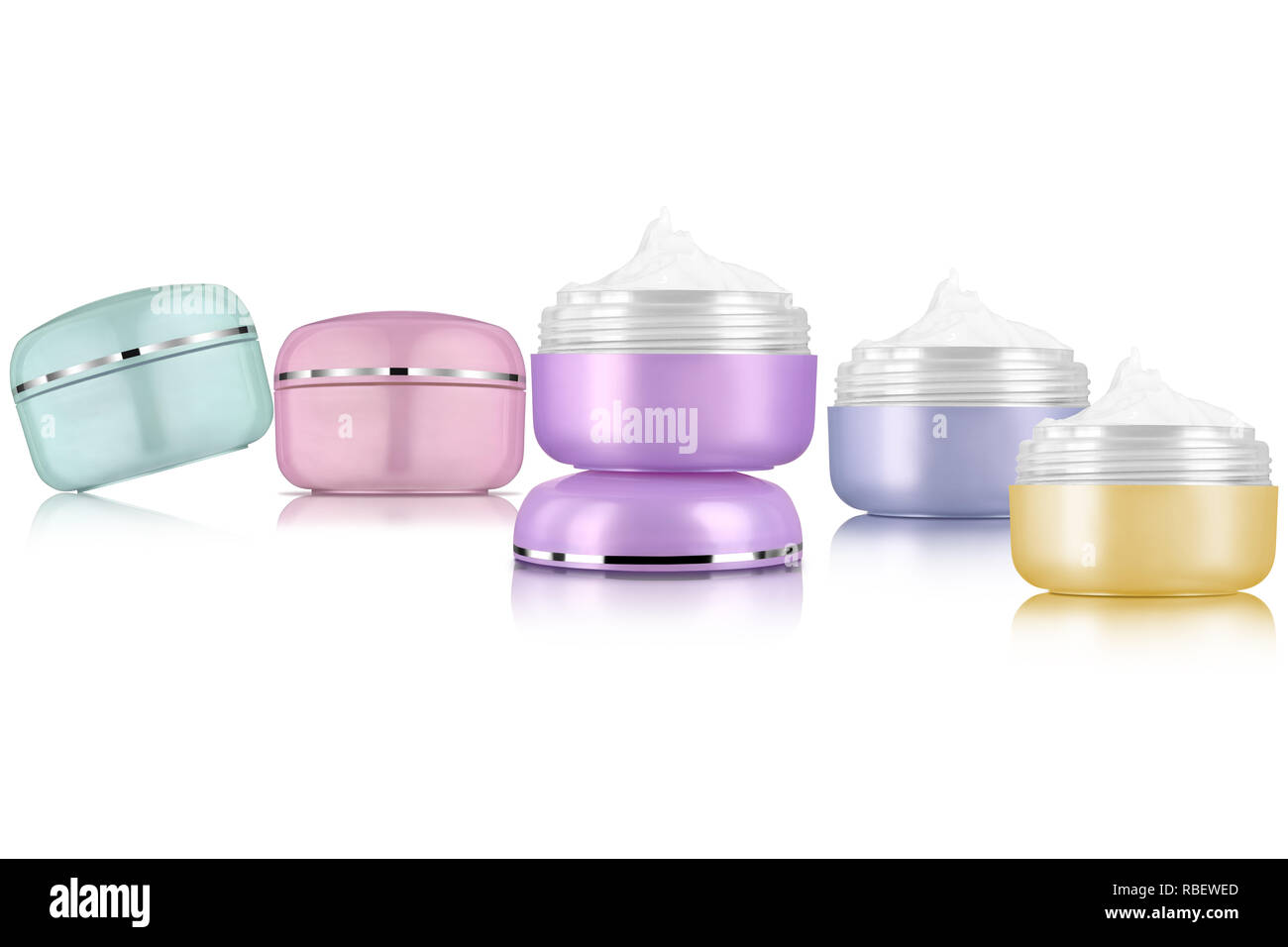 Facial cosmetic cream assortment of various colors, isolated on white background - Stock Image