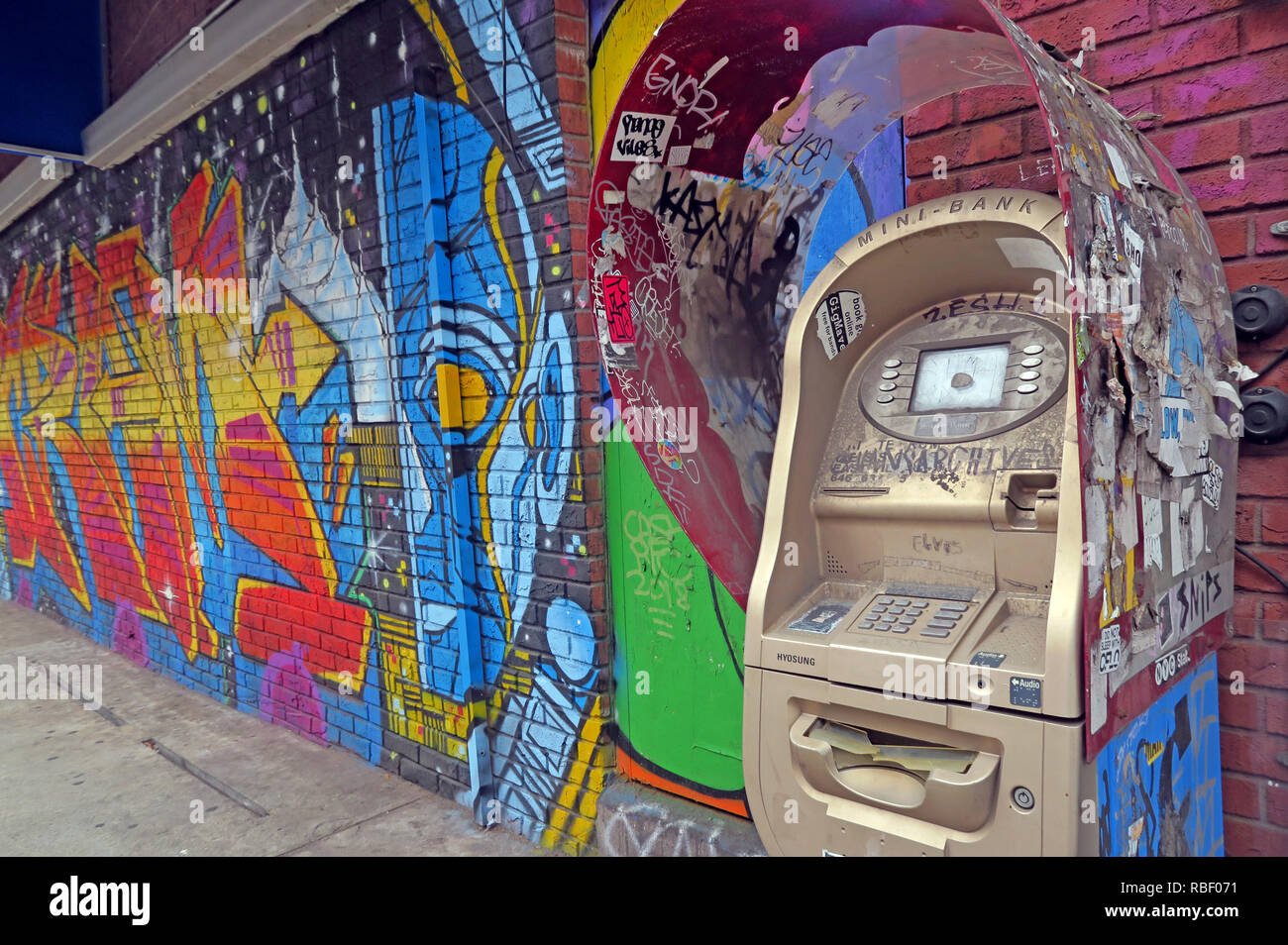 Money and Art, ATM at East 7th Street, East Village, Manhattan, New York, NY, USA Stock Photo