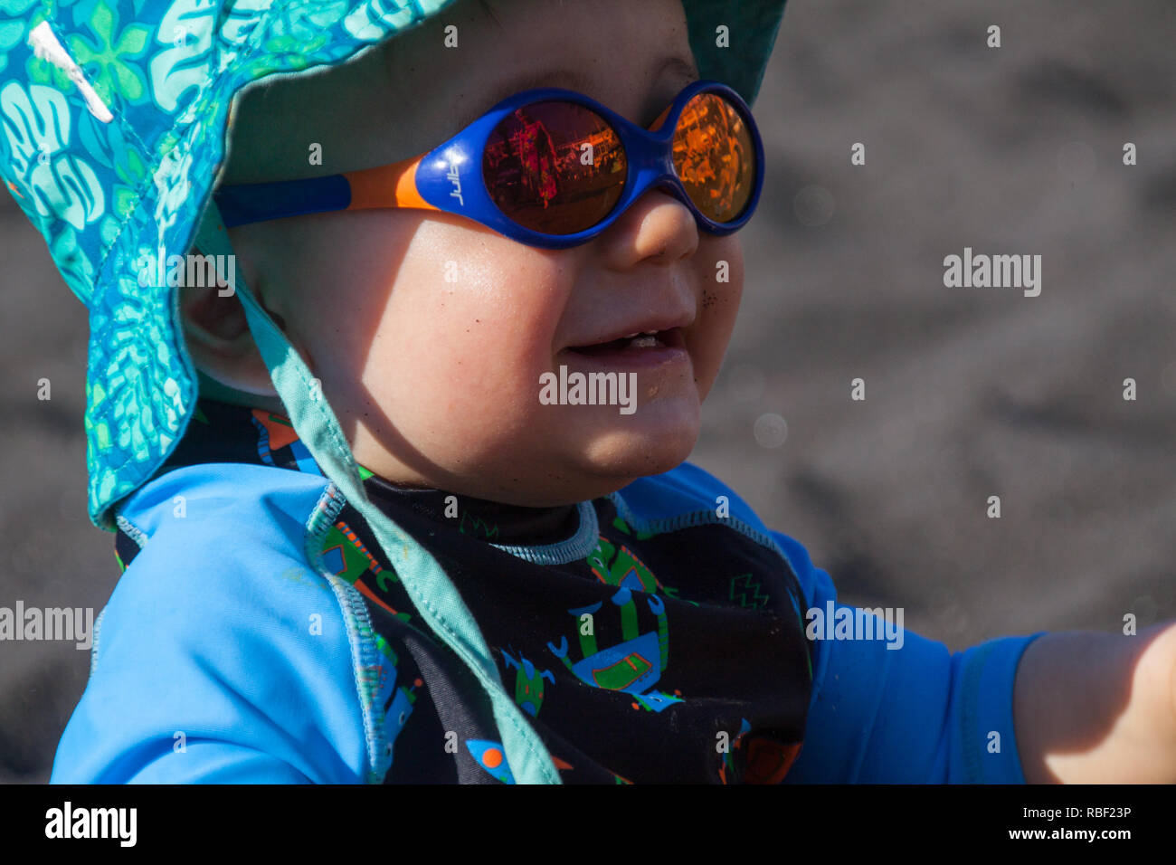 0f4efb82eb47 A nice portrait of a young boy wearing sunglasses and laughing - Stock Image