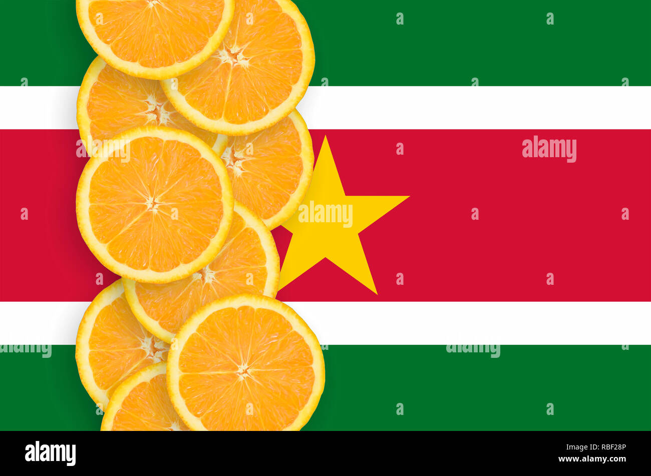 Suriname flag and vertical row of orange citrus fruit slices. Concept of growing as well as import and export of citrus fruits - Stock Image