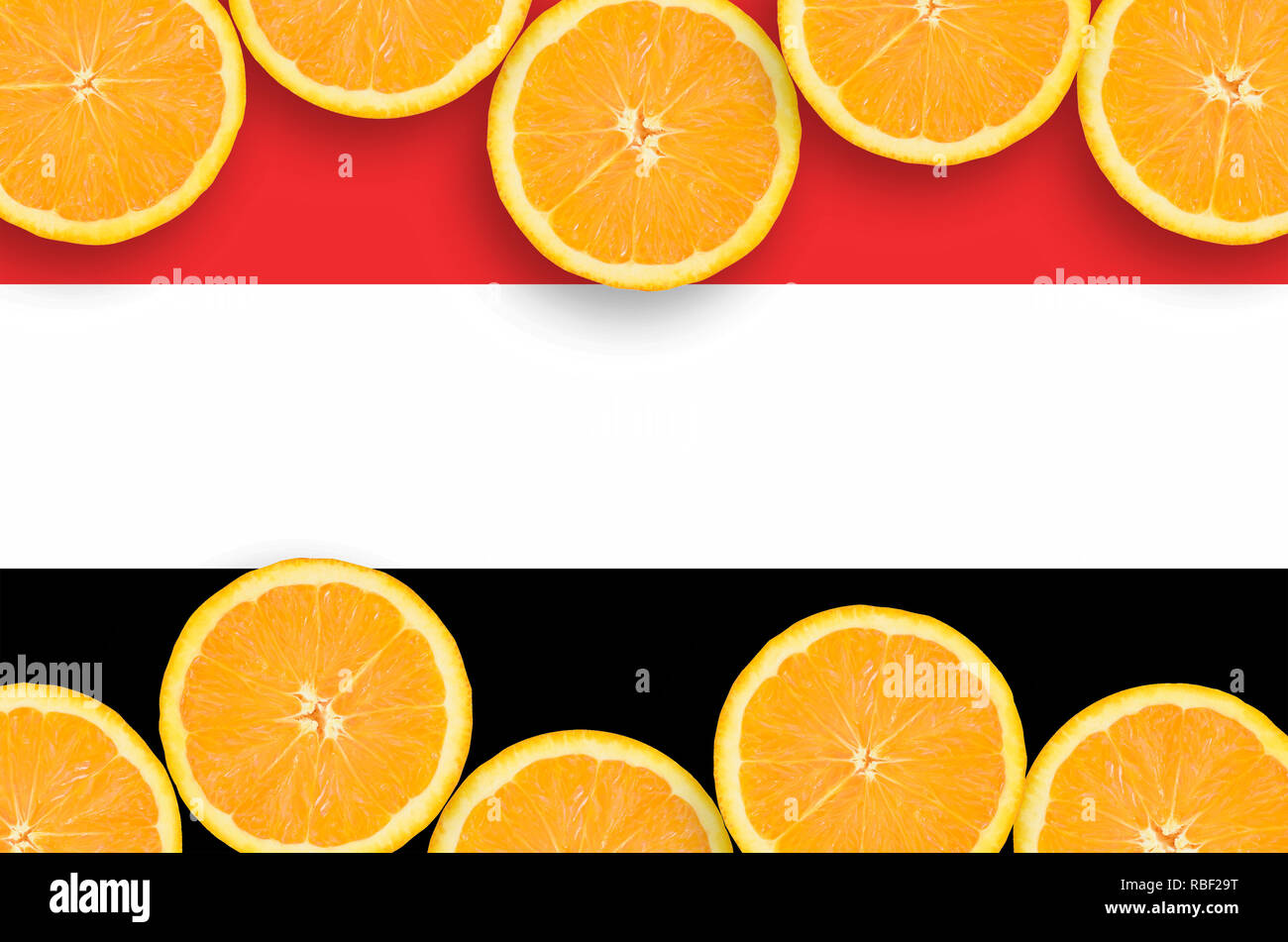 Yemen flag  in horizontal frame of orange citrus fruit slices. Concept of growing as well as import and export of citrus fruits - Stock Image