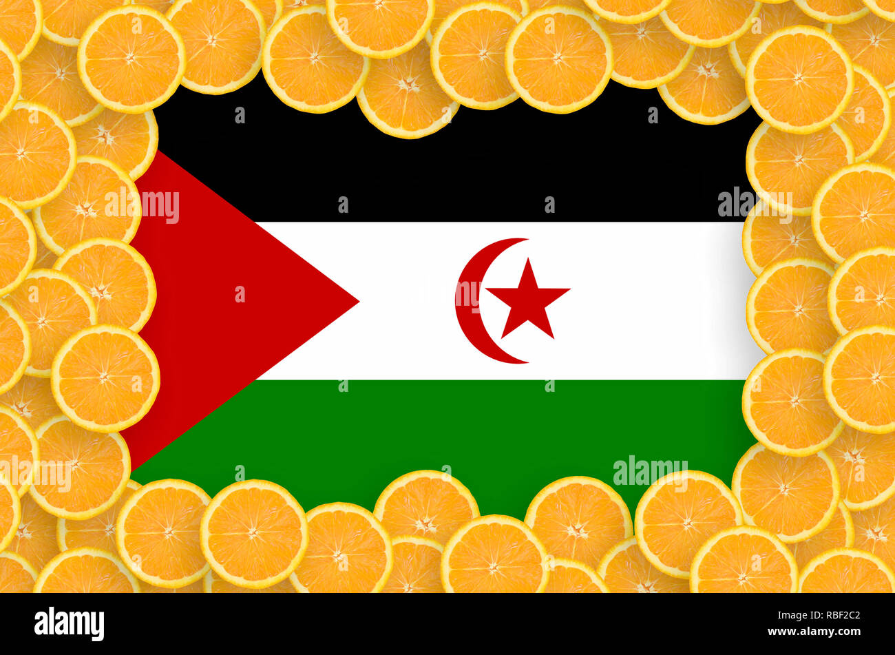 Western Sahara flag  in frame of orange citrus fruit slices. Concept of growing as well as import and export of citrus fruits - Stock Image