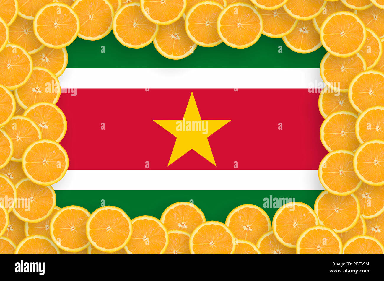 Suriname flag  in frame of orange citrus fruit slices. Concept of growing as well as import and export of citrus fruits - Stock Image