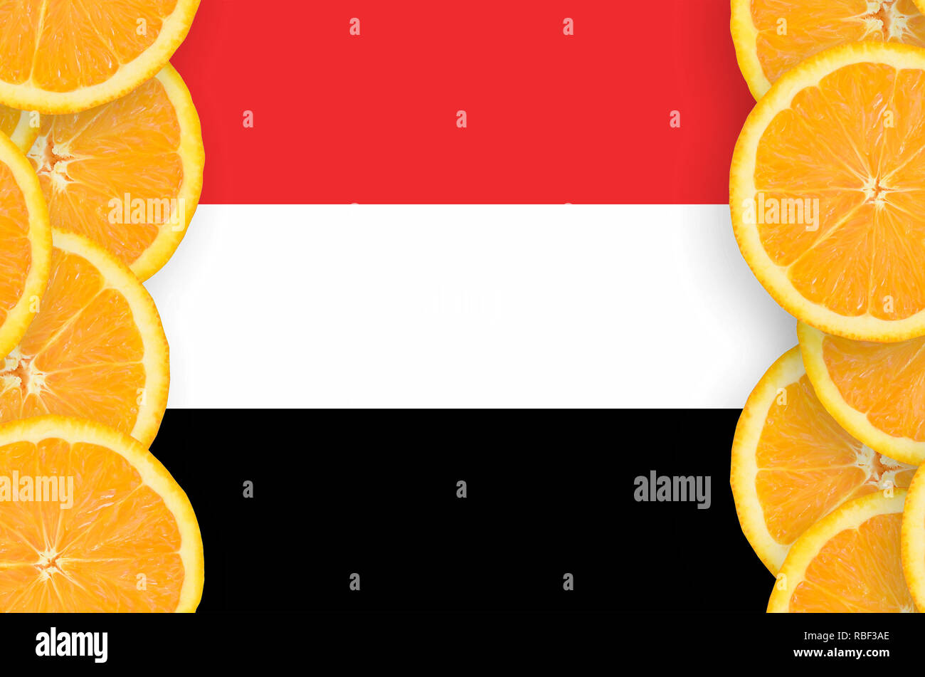 Yemen flag  in vertical frame of orange citrus fruit slices. Concept of growing as well as import and export of citrus fruits - Stock Image