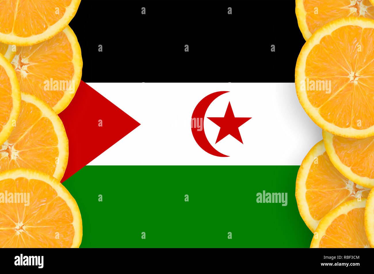 Western Sahara flag  in vertical frame of orange citrus fruit slices. Concept of growing as well as import and export of citrus fruits - Stock Image