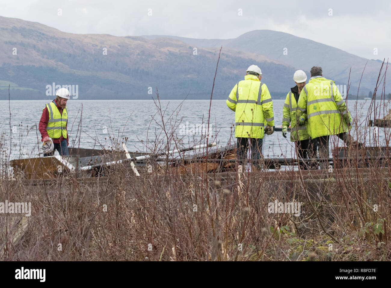 Balloch, Loch Lomond, Scotland, UK. 10th Jan, 2018. The Maid of the Loch has broken free as she was being hauled from Loch Lomond. Minutes after the incident workers survey the broken carriage which appeared to break as she was being hauled up the slipway. The ship fell backwards down the slipway with workers scattering out of the way just in time. Credit: Kay Roxby/Alamy Live News - Stock Image