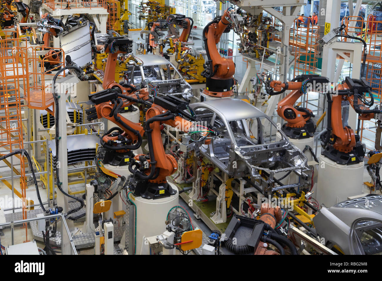 body of car on conveyor top view. Modern Assembly of cars at the plant. The automated build process of the car body Stock Photo