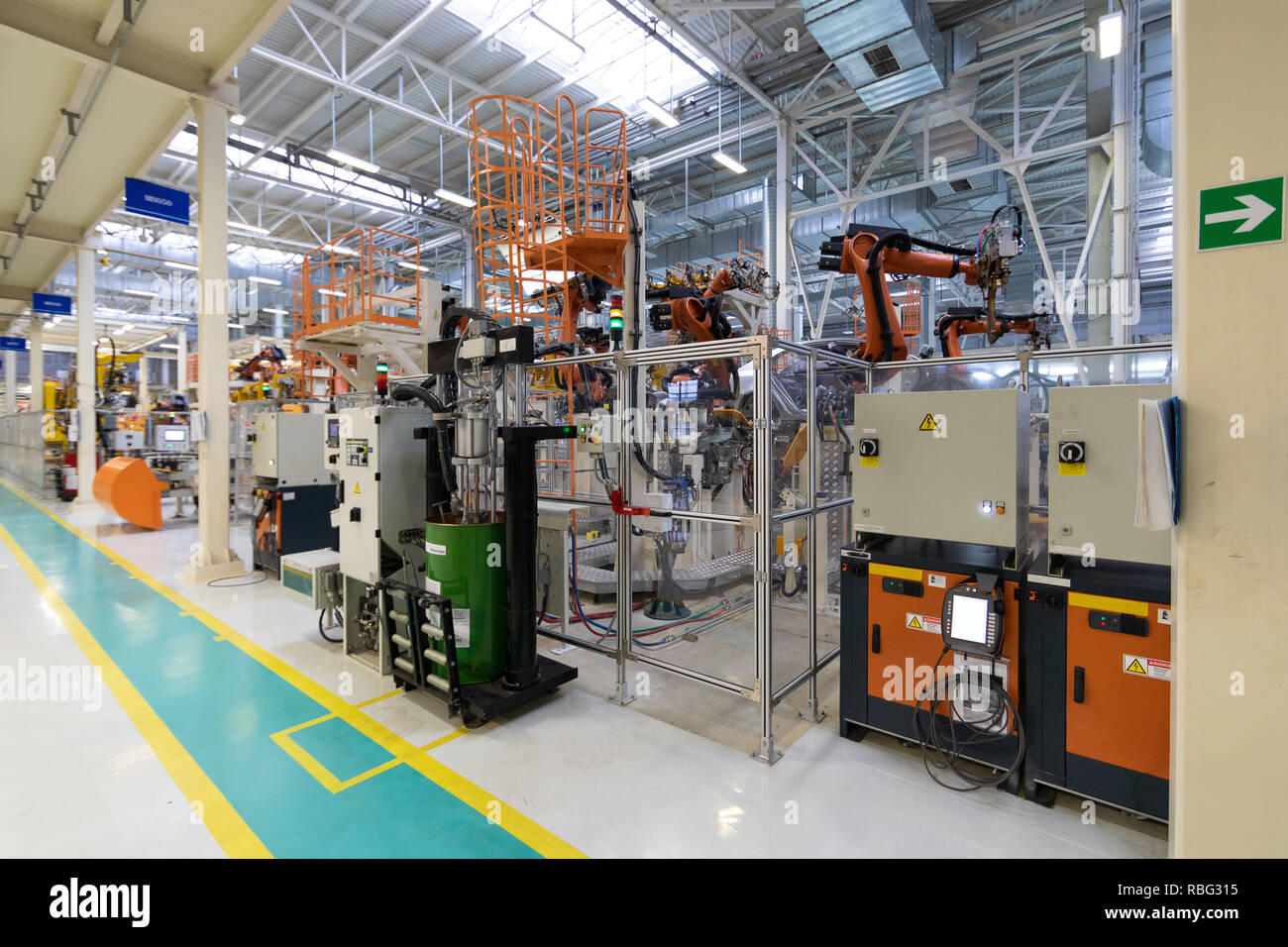 Car manufacturing plant. Automotive shop. The Assembly line for manufacturing cars. - Stock Image