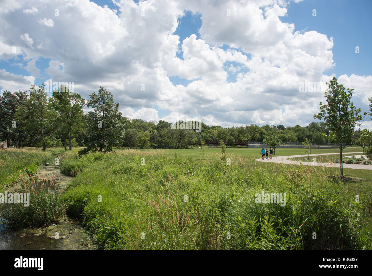 Naperville, Illinois, United States-June 27,2017: People walking the footpath at Knoch Knolls nature reserve in Naperville, Illinois - Stock Image