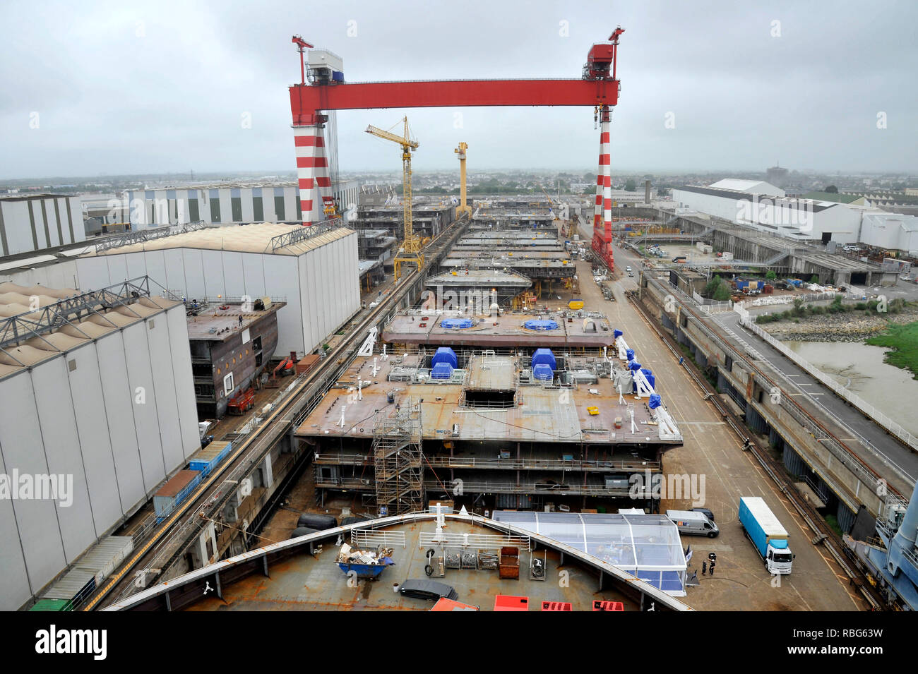 STX shipyards in Saint-Nazaire (north-western France),STX shipyards in Saint-Nazaire on 2018/06/14: overview with the bow of the MSC Bellissima cruise - Stock Image