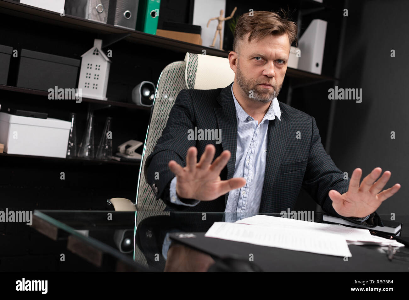 Businessman conducting an interview in stylish office - Stock Image