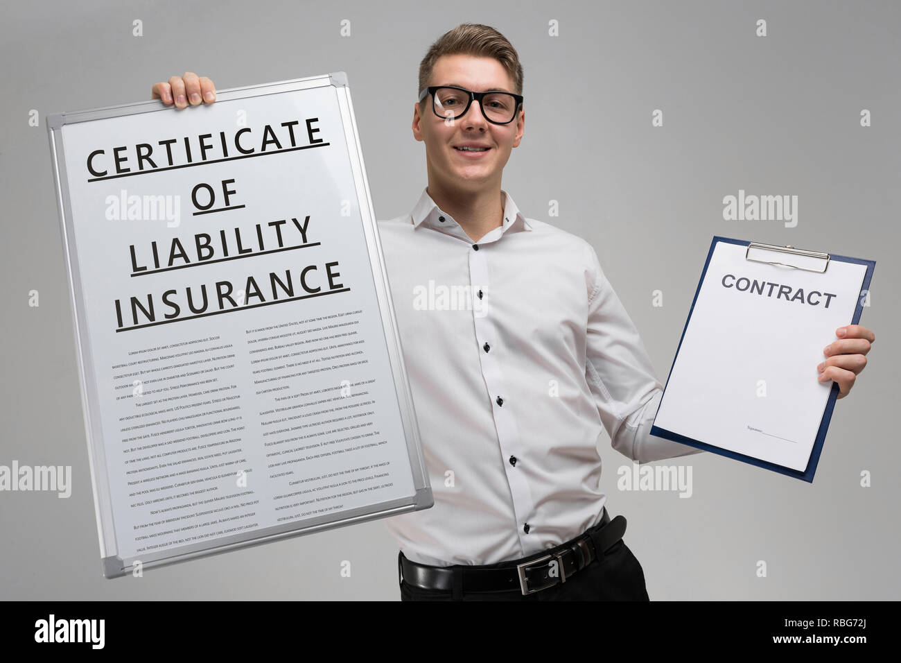 man holds a poster with inscription certificate of liability insurance and an empty certificate isolated - Stock Image